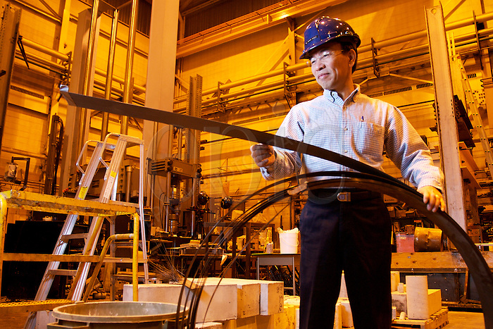 Dr.  Roger Cheng, Chair of civil and environmental engineering at the U of Alberta,  specializes structural monitoring and smart buildings. Here he inspects a roll of carbon fibre, in Edmonton, on Wednesday December 5, 2007, which will be used to strengthen walls and pillars..John Ulan/Epic Photography