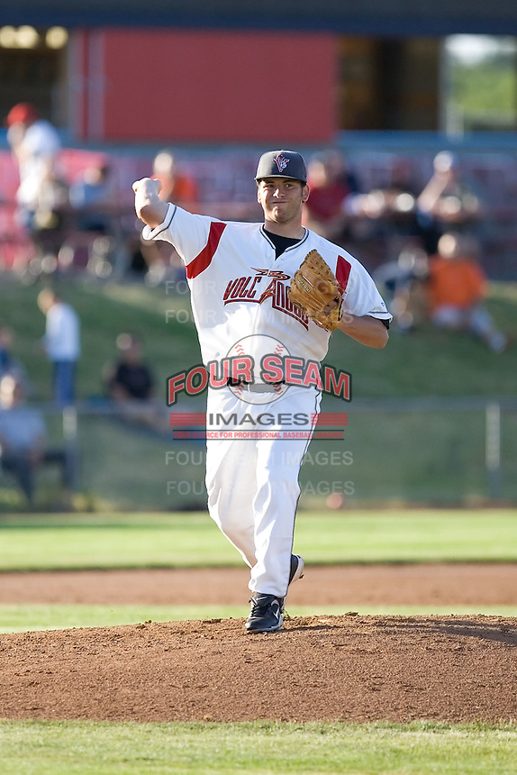 July 7, 2009: Salem-Keizer Volcanoes pitcher Jeremy Toole makes a pickoff attempt to first base during a Northwest League game against the Tri-City Dust Devils at Volcanoes Stadium in Salem, Oregon.