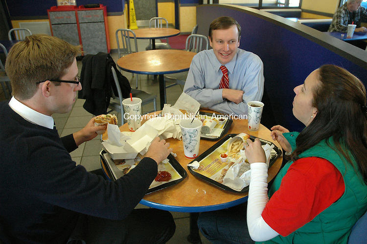 TORRINGTON, CT- 06 November 2012- 110612BJ01-- Congressman Chris Murphy eats his good luck meal from Burger King in Torrington. Murphy visited the eatery after visiting the Armory. Bruno Matarazzo Jr. Republican-American