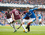 Niko Kranjcar up against a maroon wall