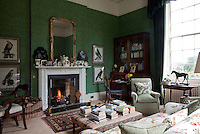 An open fire in the green morning room welcomes visitors to Fort William to sit and read