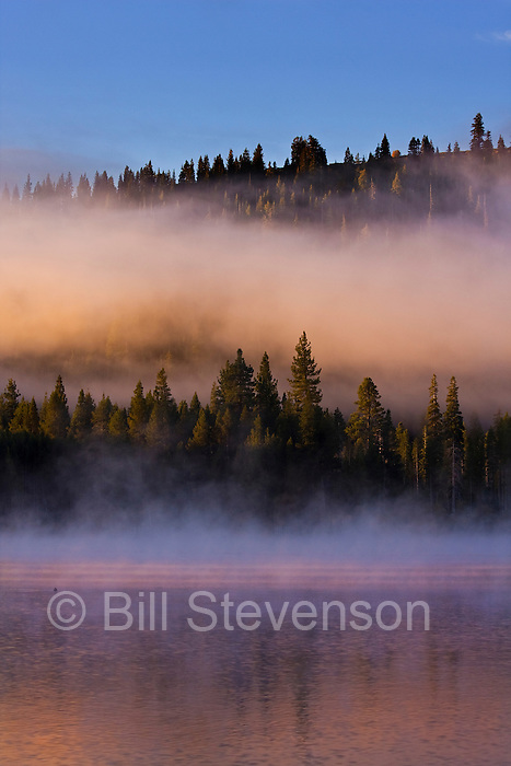 A photo of fog on Donner Lake in the early morning.