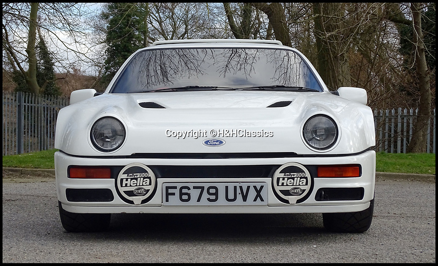 BNPS.co.uk (01202 558833)Picture: H&HClassics/BNPS<br /> <br /> 32 year old Ford sells for the price of a Ferrari - An incredibly rare Ford rally car has sold for a staggering £132,000.<br /> <br /> Lacking sat-nav, radio or even a boot, the RS200 was built by Ford's motorsport department for the prestigious Group B class Swedish Finnish rally in 1986.<br /> <br /> However the super fast class was banned shortly afterwards after a string of fatal accidents and the all white racer never saw a rally stage.<br /> <br /> As a result the 450hp monster has only 4000 miles on the clock.<br /> <br /> It has now been sold at auction at H&H Classics of Cheshire.