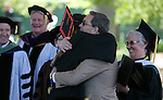 Carson City Superintendent Richard Stokes hugs his daughter Jazmyn during the 2013 Western Nevada College Commencement at the Pony Express Pavilion, in Carson City, Nev., on Monday, May 20, 2013. .Photo by Cathleen Allison
