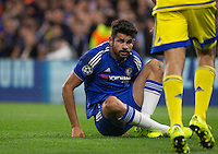 Diego Costa of Chelsea is floored during the UEFA Champions League match between Chelsea and Maccabi Tel Aviv at Stamford Bridge, London, England on 16 September 2015. Photo by Andy Rowland.