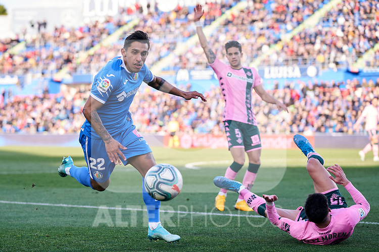 Damian Suarez of Getafe FC and Alex Moreno of Real Betis Balompie during La Liga match between Getafe CF and Real Betis Balompie at Wanda Metropolitano Stadium in Madrid, Spain. January 26, 2020. (ALTERPHOTOS/A. Perez Meca)
