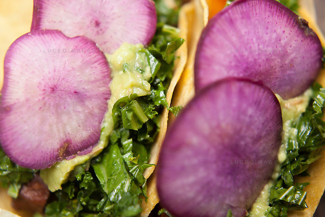 Kale tacos prepared by Rockaway Tacos visiting from New York.<br /> <br /> Kristen Beddard, 29, of The Kale Project, in Paris, France.  Kevin German / Luceo