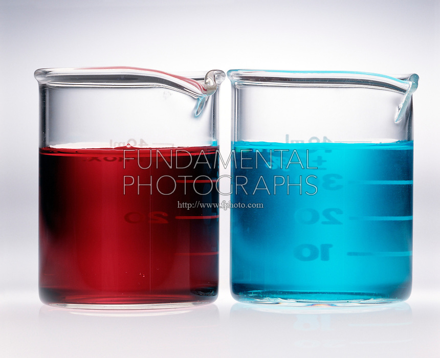TRANSITION METAL COMPLEX SOLUTIONS<br /> (1 of 3)<br /> Cobalt Nitrate and Copper II Nitrate.(left) Solution of pink Co(NO3)2*6H2O (complex ion is Co(H2O)6 2+). (right)  Solution of blue Cu(NO3)2*6H2O (complex ion is Cu(H2O)6 2+).