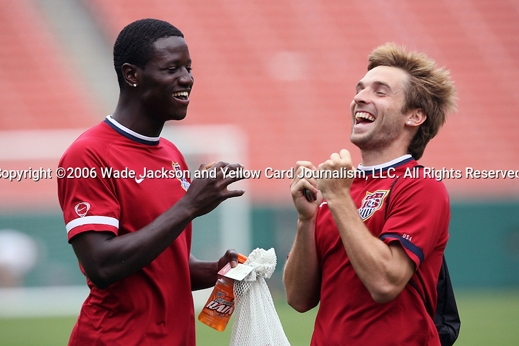 25 May 2006,  Eddied Johnson (L) and Bobby Convey (R) play a game of rock-paper-scissors after practice.  The USA Mens National soccer team held a practice session before taking on Venezuela in an international friendly match at Cleveland Browns Stadium in Cleveland, Ohio in their preparation for competition at World Cup 2006 in Germany.