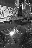 (021303-SWR09.jpg) New York, NY -- Circa 1988 - Workers repair, restore, and do routine maitenance on subway cars at the  New York City;s Transity Authority 211th Street Lay Ups.