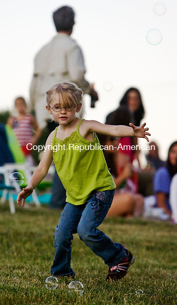 SALISBURY. CT - 03 JULY 2010 -070310JT04-<br /> Zoe Parsons, 5, of Sandisfield, Mass. chases bubbles made by her cousin Deonna Landi at Lime Rock Park in Salisbury before the Independence Day fireworks display on Saturday.<br /> Josalee Thrift Republican-American