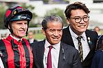 Jockey Zac Purton (L) rode #3 Time Warp, and trainer Tony Cruz (C) pose for photo  after winning the Race 7 Sa Sa Ladies' Purse (G3 1800m) at Sha Tin Racecourse on November 04, 2018 in Hong Kong, Hong Kong. Photo by Yu Chun Christopher Wong / Power Sport Images