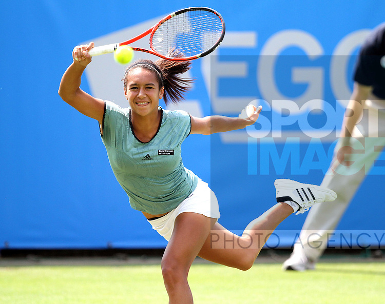 Heather Watson of Great Britain plays a shot