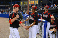 Batavia Muckdogs pitcher Ryan Newell (38) is greeted by Carlos Lopez and Scott Carcaise after going 8 hitless innings giving up a bloop single in the ninth during a game against the Aberdeen Ironbirds on August 10, 2013 at Dwyer Stadium in Batavia, New York.  Batavia defeated Aberdeen 1-0.  (Mike Janes/Four Seam Images)