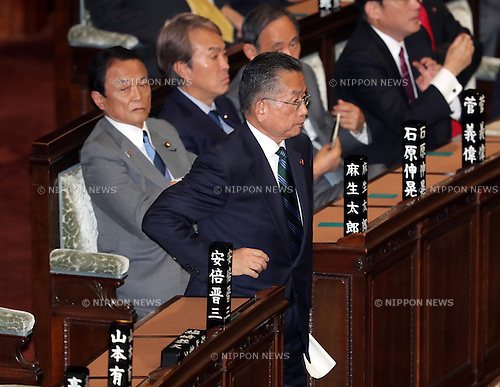 November 10, 2016, Tokyo, Japan - Japanese Agriculture Minister Yuji Yamamoto votes for his no-confidence motion at the Lower House plenary session at the National Diet in Tokyo on Thursday, November 10, 2016, while Finance Minister Taro Aso (L) looks on. The no-confidence motion brought by opposition parties for Yamamoto's verbal gaffes was voted down by ruling parties.  (Photo by Yoshio Tsunoda/AFLO) LWX -ytd-