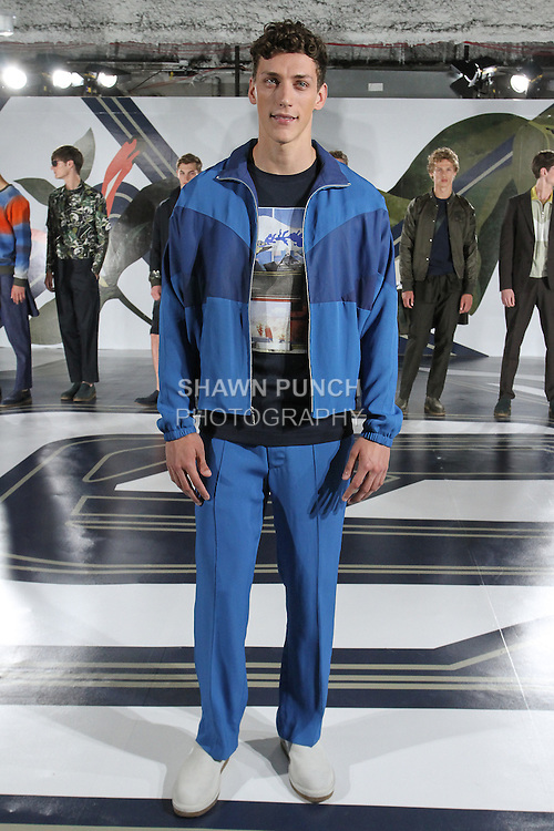 Model Lane poses in a gym suit lapis t-shirt in navy, from the Perry Ellis Spring 2017 collection by Michael Maccari, on July 11th 2017, during New York Fashion Week Men's Spring Summer 2017.