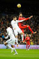 Real Madrid´s Nacho Fernandez and Sevilla's  during 2014-15 La Liga match between Real Madrid and Sevilla at Santiago Bernabeu stadium in Alcorcon, Madrid, Spain. February 04, 2015. (ALTERPHOTOS/Luis Fernandez) /NORTEphoto.com