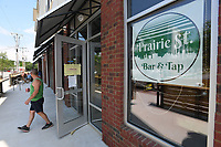 NWA Democrat-Gazette/J.T. WAMPLER Dan Daniel takes a break from painting Thursday June 7, 2018 at Prairie St. Bar and Tap in Fayetteville. The new watering hole, opening later this summer, will be a private club. A state law enacted last year requires municipalities to approve private club applications before the state reviews them. The Fayetteville City Council approved Prairie Street Bar & TaproomÕs private club application in April. Daniel is the general manager at the club.