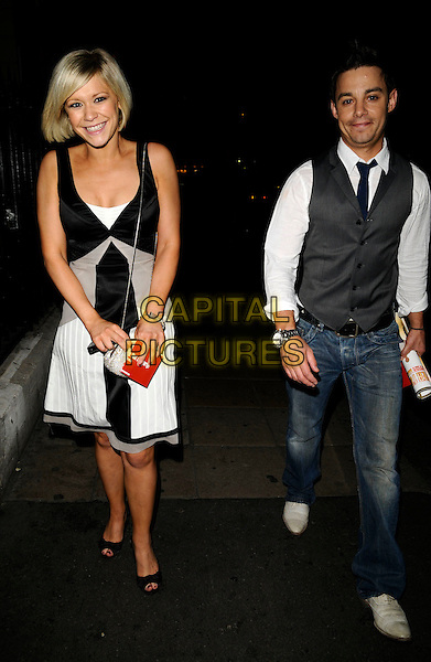 "SUZANNE SHAW & GUEST.The ""Never Forget"" gala night afterparty, 1 The piazza, Covent garden, London, England..May 22nd, 2008.after party full length black white grey gray dress waistcoat jeans denim couple .CAP/CAN.©Can Nguyen/Capital Pictures."