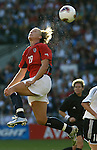 PORTLAND, OREGON - OCTOBER 5:  Abby Wambach of the United States heads the ball during a Women's World Cup semifinal soccer match against Germany October 5, 2003 in Portland, Oregon.  Editorial use only.  Commercial use prohibited.  (Photograph by Jonathan Paul Larsen)