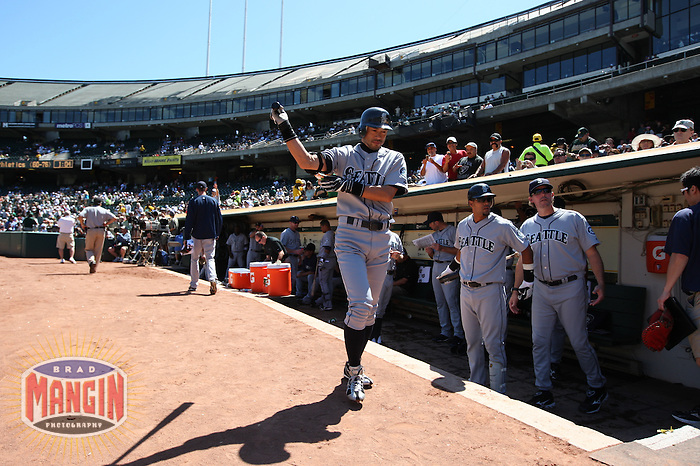 OAKLAND, CA - SEPTEMBER 6:  Ichiro Suzuki #51 of the Seattle Mariners leaves the dugout and walks towards home plate to lead off the game before the game against the Oakland Athletics at the Oakland-Alameda County Coliseum on September 6, 2009 in Oakland, California. Photo by Brad Mangin