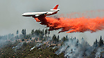 DC-10 tanker drops retardant to slow down active fire on Crocker Ridge below Pilot Peak.  Firefighters hope to hold fire with backfires on Crocker Ridge in the next few days.  This area is adjacent to Yosemite National Park and the Merced Grove of Big Trees.