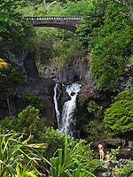 THE BRIDGE AND WATERFALL ABOVE THE POOLS IN OHE'O GULCH IN HALEAKALA NATIONAL PARK ON MAUI IN HAWAII USA