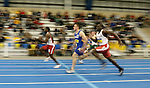 BROOKINGS, SD - FEBRUARY 24:  Gawain Williams from the University of South Dakota leads Sam Zenner from South Dakota State University during the mens 60 meter prelims Friday afternoon at the Summit League Indoor Championships in Brookings, SD. (Photo by Dave Eggen/Inertia)