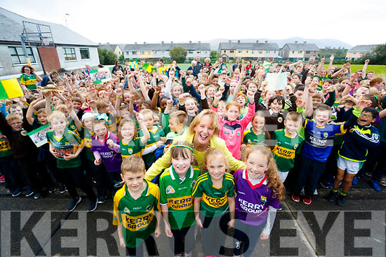 Pictured at Gaelscoil Mhic Easmainn on Wednesday last, wishing the Kerry Minor team the very best of luck for Sunday, in foreground were l-r: Eoghan Ó Dálaigh, Brid Ní Shúilleabháin, Cait Uí Chonchúir (Principal) with Alannah De Róiste and Orla Buitiméir.