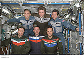 The Expedition Four and Soyuz 4 Taxi crews pose for a group photo in the Destiny laboratory on the International Space Station (ISS). The Soyuz 4 Taxi crew (front row), from the left, are flight engineer Roberto Vittori, commander Yuri Gidzenko, and South African space flight participant Mark Shuttleworth. The Expedition Four crew (back row), from the left, are astronaut Carl E. Walz, flight engineer; cosmonaut Yury I.<br /> Onufrienko, mission commander; and astronaut Daniel W. Bursch, flight engineer. Onufrienko and Gidzenko represent Rosaviakosmos and Vittori represents the European Space Agency (ESA). <br /> Credit: NASA via CNP