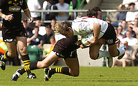 Twickenham, GREAT BRITAIN, 2004 Heineken Cup Final.Cedric Heymans, is tackled by Frazer Waters, during the  London London Wasps v Toulouse, final at Twickenham on  23/05/2004  [Credit Peter Spurrier/Intersport Images].   [Mandatory Credit, Peter Spurier/ Intersport Images].