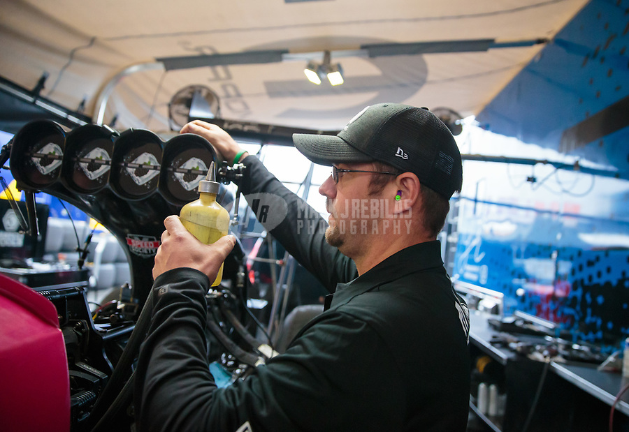 Feb 10, 2019; Pomona, CA, USA; Crew member for NHRA top fuel driver Leah Pritchett during the Winternationals at Auto Club Raceway at Pomona. Mandatory Credit: Mark J. Rebilas-USA TODAY Sports