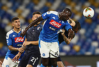 1st August 2020; Stadio San Paolo, Naples, Campania, Italy; Serie A Football, Napoli versus Lazio; Kalidou Koulibaly of Napoli  wins a clearling header under pressure
