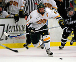 5 January 2007: University of Vermont forward and co-captain Torrey Mitchell (9) from Greenfield Park, QC, in action against the University of New Hampshire Wildcats at Gutterson Fieldhouse in Burlington, Vermont. The UNH Wildcats defeated the UVM Catamounts 7-1 in front of a record setting 48th consecutive sellout at &quot;the Gut&quot;...Mandatory Photo Credit: Ed Wolfstein Photo.<br />