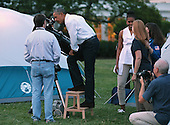 United States President Barack Obama looks through a telescope while hosting a group of Girl Scouts for an overnight campout at the White House June 30, 2015 in Washington, DC. The president and first lady Michelle Obama hosted the event as part of the first lady's Let's Move! Outside initiative and for Girl Scouts to earn the new Girls' Choice Outdoor badge. <br /> Credit: Chip Somodevilla / Pool via CNP