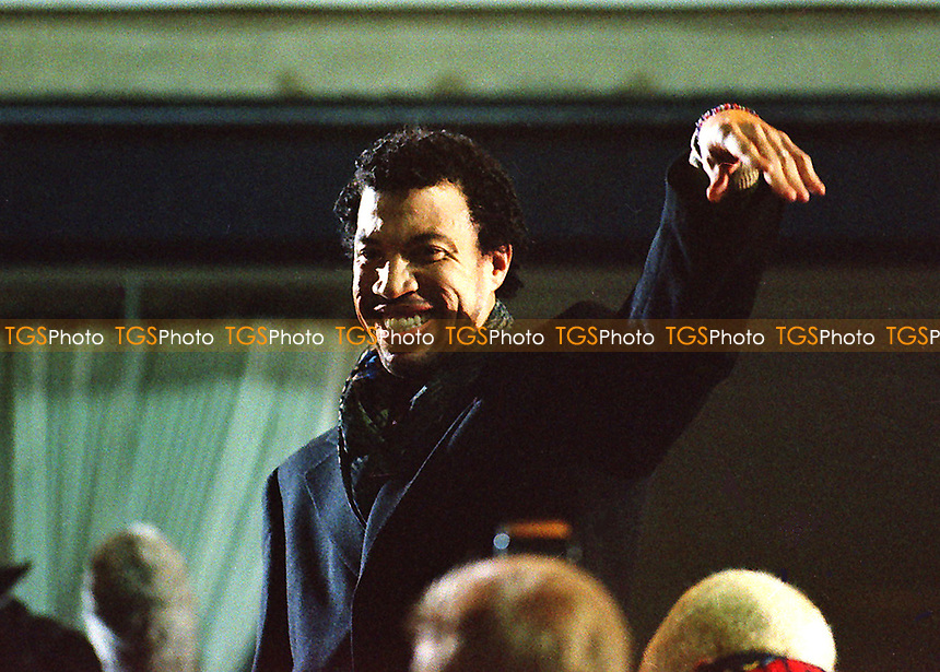 American singer songwriter, composer, Lionel Richie waves at Wycombe fans from the Executive boxes after singing his recent record release, Angel, to the fans during Wycombe Wanderers vs Notts County, Nationwide League Division Two Football at Adams Park on 6th October 2000