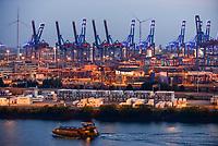 GERMANY Hamburg, light installation  blue port, HHLA container terminal and Nordex wind turbine in harbour / DEUTSCHLAND Hamburg, blue port Lichtinstallation im Hamburger Hafen von Michael Batz, Suederelbe, HHLA und Eurogate Containerterminal mit Nordex Windkraftanlagen