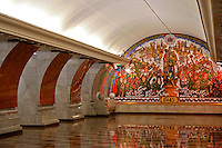 """Park Pobedy Station, Moscow Metro; """"Victory 1945"""" Muralist: T. Tsereteli -<br /> Park Pobedy Station or """"Victory Park"""" is  84 metres underground and the deepest station on the Moscow Metro. It also contains the longest escalators in Europe, at 126 metres long and has 740 steps. The ride to the surface takes approximately three minutes."""