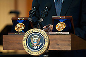 Gershwin Prizes are seen on the podium as United States President Barack Obama delivers remarks at a concert honoring award winners Burt Bacharach and Hal David, in the East Room at the White House in Washington on May 9, 2012.  .Credit: Kevin Dietsch / Pool via CNP