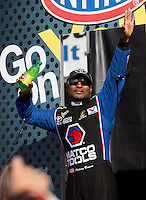 Nov 10, 2013; Pomona, CA, USA; NHRA top fuel dragster driver Antron Brown during the Auto Club Finals at Auto Club Raceway at Pomona. Mandatory Credit: Mark J. Rebilas-