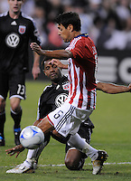 DC United forward Luciano Emilio (11) makes a pass while cover by Chivas USA defender Ante Jazic (6).  Chivas USA defeated DC United 2-0  at RFK Stadium, Saturday October 3, 2009.