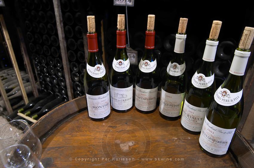 bottles on barrel for tasting bouchard p & f beaune cote de beaune burgundy france