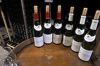 bottles on barrel for tasting bouchard p & f beaune cote de beaune burgundy france