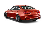 Car pictures of rear three quarter view of a 2018 BMW M3 4 Door Sedan Angular Rear