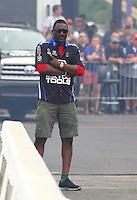 Apr 24, 2015; Baytown, TX, USA; Movie actor Idris Elba in attendance during NHRA qualifying for the Spring Nationals at Royal Purple Raceway. Mandatory Credit: Mark J. Rebilas-