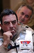 Actor Tom Selleck listens to a safety briefing conducted by Commander Carl Garbelotti, Safety Officer, prior to observing flight operations aboard USS Ronald Reagan (CVN 76) in the Pacific Ocean on July 22, 2004. The ship is completing its journey from Norfolk, Virginia, circumnavigating South America and will moor at its new homeport of San Diego, California on July 23, 2004. While in transit, the ship visited the ports of Rio de Janeiro, Brazil, Valparaiso, Chile and Callao, Peru.<br /> Mandatory Credit: Kitt Amaritnant / USN via CNP