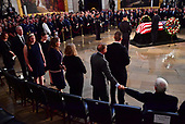 Vice President of the United Staes Mike Pence and United States Senator Lindsey Graham hold hands with a view of the casket of former Senator John McCain in the Capitol Rotunda where he will lie in state at the U.S. Capitol, in Washington, DC on Friday, August 31, 2018. McCain, an Arizona Republican, presidential candidate and war hero died August 25th at the age of 81. He is the 31st person to lie in state at the Capitol in 166 years.    Photo by Kevin Dietsch/UPI