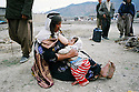 Iran 1991 A grandmother milking her grandson who lost his mother   Iran 1991 Une grand-mere allaitant son petit-fils qui est orphelin de mere