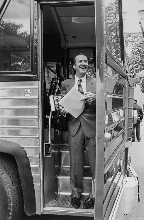 Rep. Sonny Bono, R-Calif., leaves for GOP retreat, with Tom Clancy's Debt of Honor in his right hand. He said he felt like 'he was going off to college or war'. 1996 (Photo by Maureen Keating/CQ Roll Call via Getty Images)