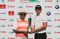 Matt Wallace (ENG) winner of the Hero Indian Open with Pawam Munjal (Chairman Hero Motocorp) at the DLF Golf and Country Club, New Delhi on Sunday 11th March 2018.<br /> Picture:  Thos Caffrey / www.golffile.ie<br /> <br /> All photo usage must carry mandatory copyright credit (&copy; Golffile | Thos Caffrey)